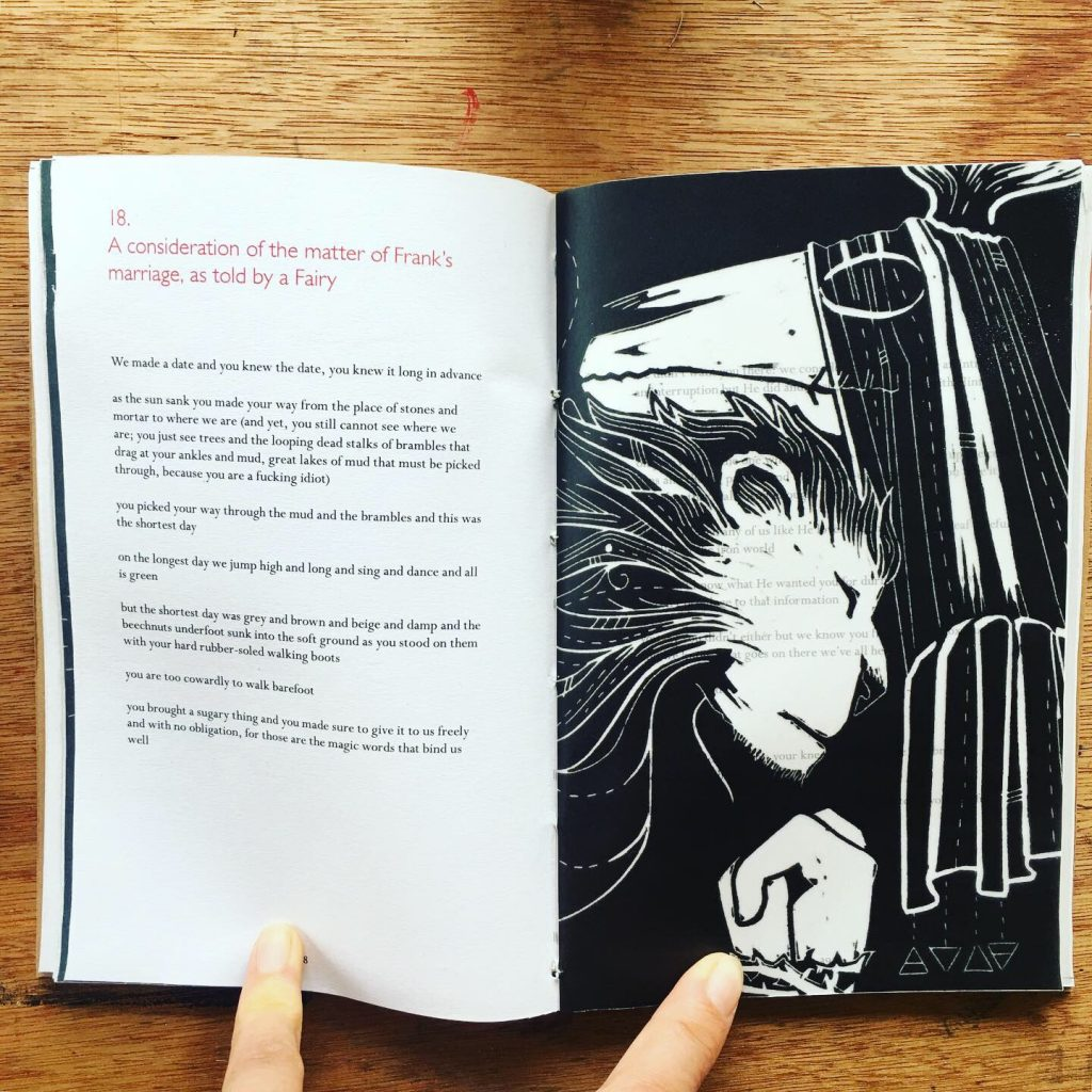 linocut illustration of lion and god, black and white, in book